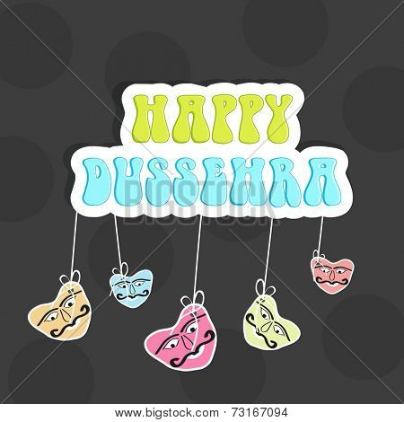 Colourful text of Happy Dussehra with funny hanging faces on seamless background.
