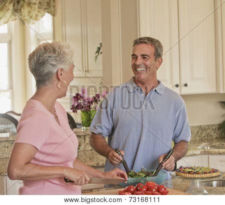 Senior Hispanic couple preparing food