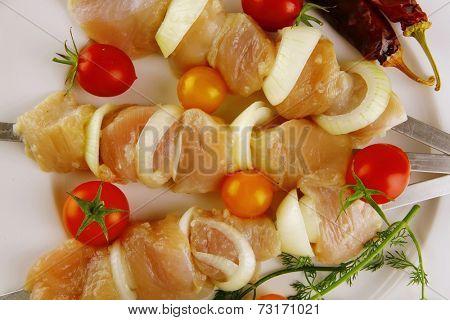 raw fresh chicken shish kebab on white plate