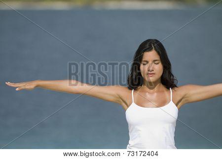 Hispanic woman practicing yoga