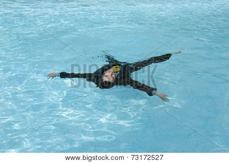 Hispanic businessman in swimming pool