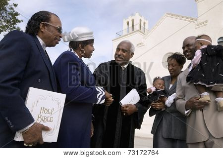 African Reverend greeting parishioners