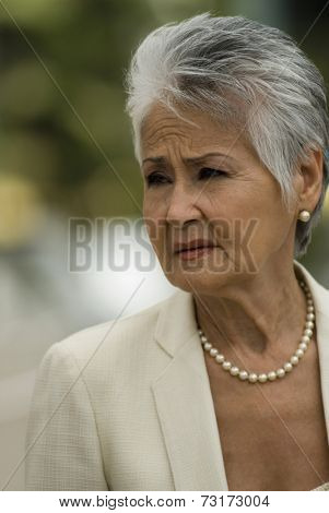 Senior Hispanic woman wearing pearls