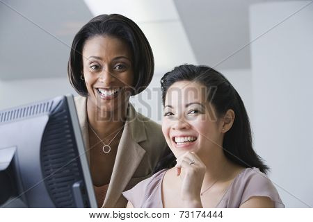 Multi-ethnic businesswomen laughing