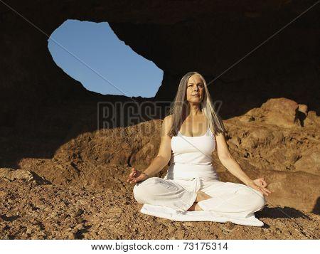 Senior Hispanic woman meditating