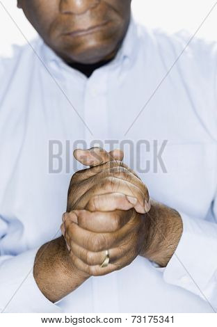 African American man with hands clasped