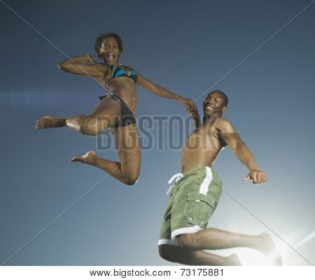 African American couple jumping
