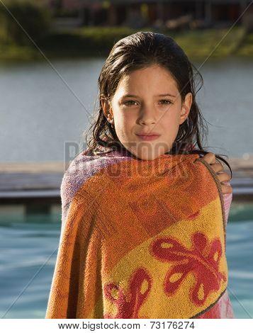 Hispanic girl wrapped in towel