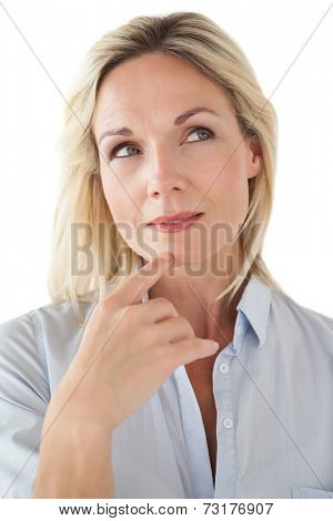 Thoughtful beautiful woman looking away over white background