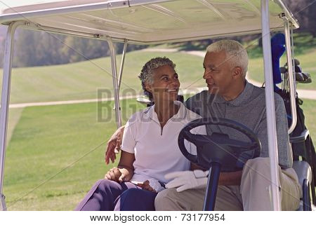 Senior African American couple in golf cart
