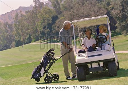 Multi-ethnic seniors on golf course