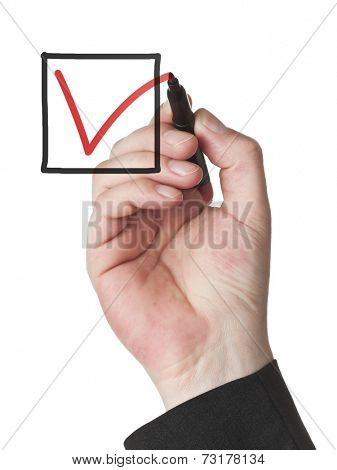 male hand with red felt tip pen marking a check box