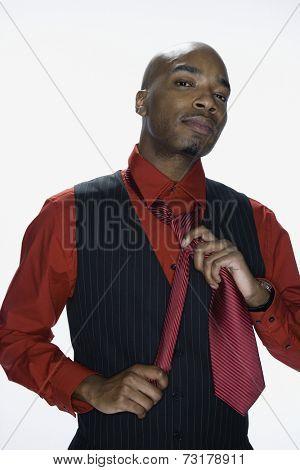 African American man adjusting tie