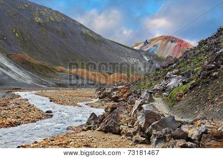 National park Landmannalaugar in Iceland. The green stone rock and stream in the gorge