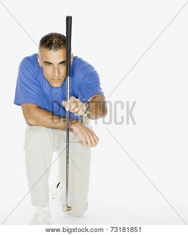 Middle Eastern man holding golf club