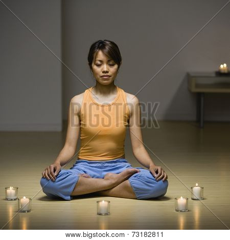 Pacific Islander woman meditating