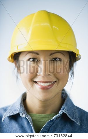Asian woman wearing hard hat