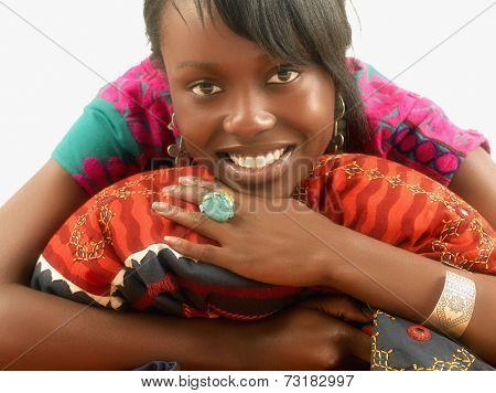 African woman hugging pillow