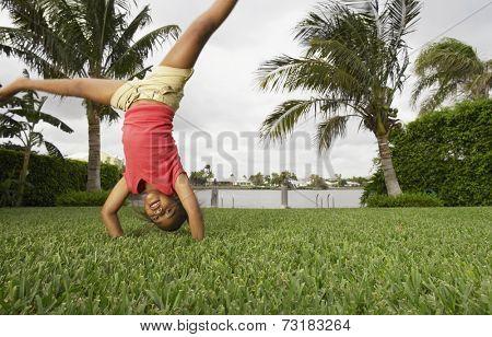 Mixed Race girl doing cartwheel