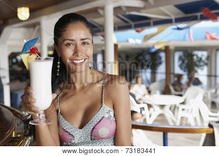 Hispanic woman holding cocktail