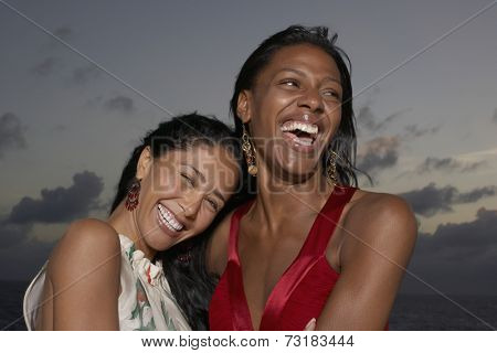 Multi-ethnic women laughing