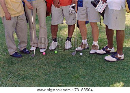 Multi-ethnic friends on golf course