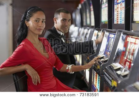 Hispanic couple at slot machines