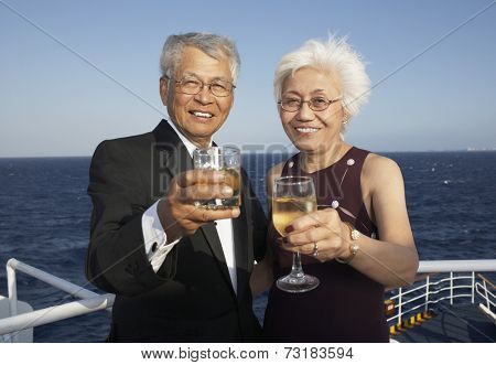 Senior Asian couple toasting