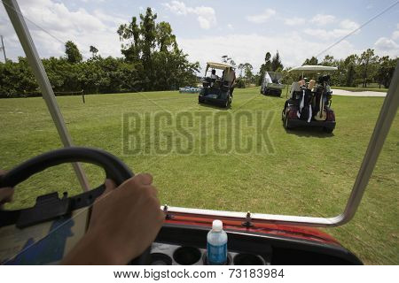 Golf carts driving on golf course