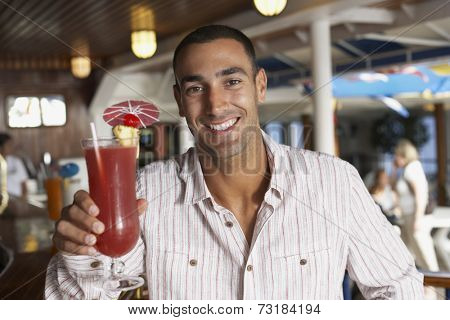 Hispanic man holding cocktail
