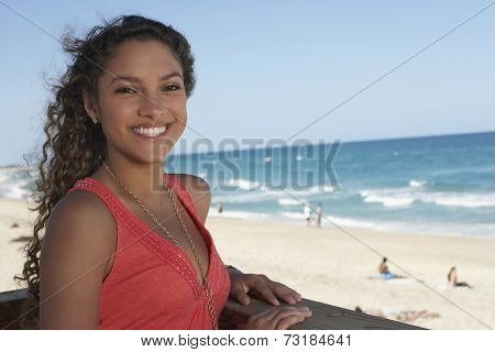 Hispanic teenaged girl at beach