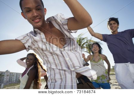 Hispanic teenaged boy with friends in background
