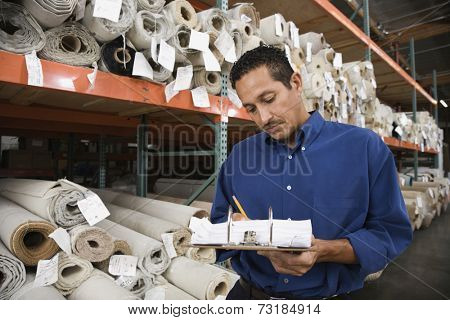Hispanic sales representative in carpet warehouse
