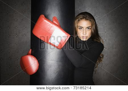 Middle Eastern woman wearing boxing gloves