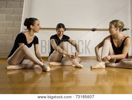 Hispanic female ballet dancers talking