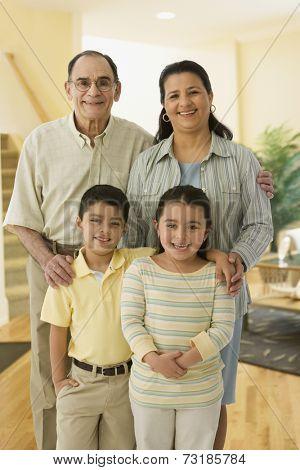 Portrait of Hispanic grandparents and grandchildren