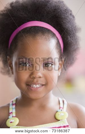 Close up of African American girl wearing headband