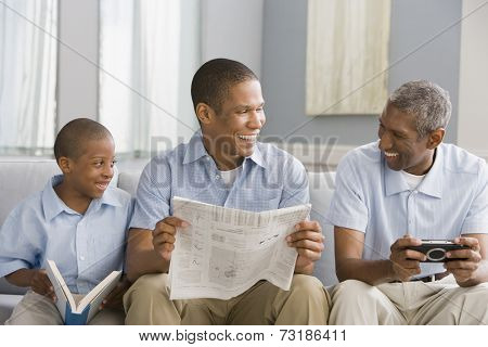 African American grandfather, father and son relaxing