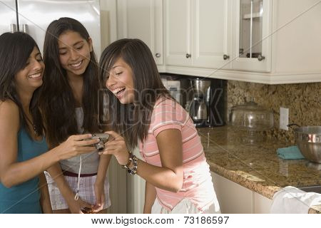 Hispanic teenaged girls looking at camera
