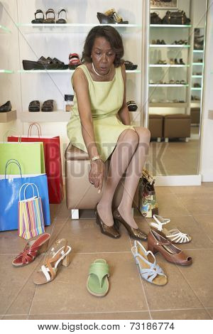 Senior African American woman shoe shopping