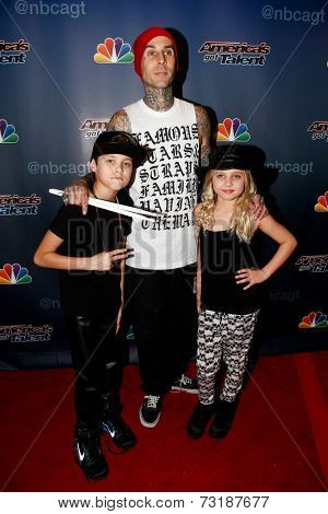 NEW YORK-SEP 17: Drummer Travis Barker (C),son Landon & daughter Alabama attend America's Got Talent: The Finale Season 9 post-show at Radio City Music Hall on September 17, 2014 in New York City.