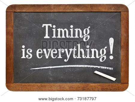 timing is everything - reminder words on a vintage slate blackboard