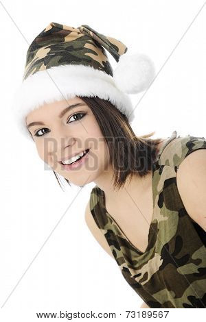 Close-up image of a beautiful teen girl dressed in a sleeveless camouflage shirt and Santa-style hat.  On a white background.
