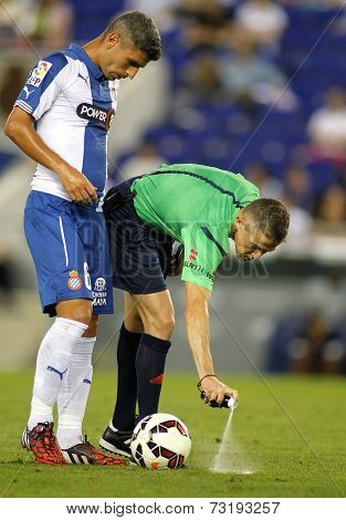 BARCELONA - SEPT, 20: Referee Iglesias Villanueva marks kick off positions with a Vanishing spray during a Spanish League match at the Estadi Cornella on September 20, 2014 in Barcelona, Spain