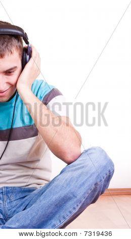 Man On The Floor With Earphones