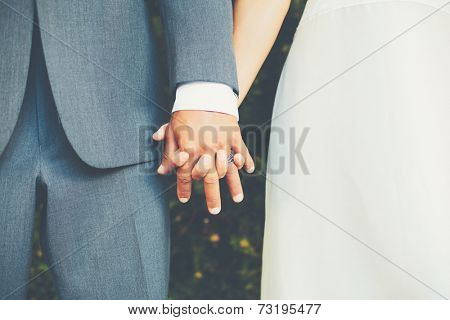 Wedding Couple, Bride and Groom Holding Hands