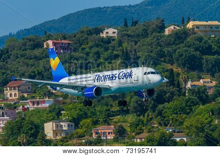 CORFU, GREECE - SEPTEMBER 29: A Thomas Cook Boeing 767 on approach on SEPTEMBER 29, 2014 in Corfu, Greece. Thomas Cook is a British charter airline