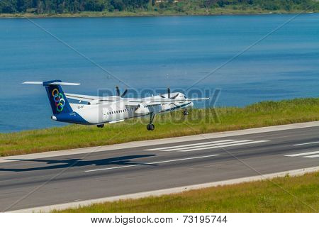 CORFU, GREECE - SEPTEMBER 29: A Olympic airways aircraft  on approach on SEPTEMBER 29, 2014 in Corfu, Greece. Olympic airways is a national Greek airline