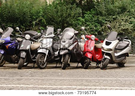PARIS - SEPTEMBER 06: modern and vintage motorbikes parked in the street on September 06, 2014 in Paris, France. Paris, aka City of Love, is a popular travel destination and a major city in Europe