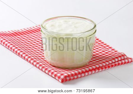 glass of kefir on checkered dishtowel